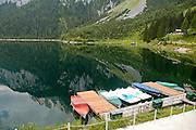 Austria, Upper Austria, Gosau, Lake Gosau in the Dachstein Mountains boats docked to a wharf