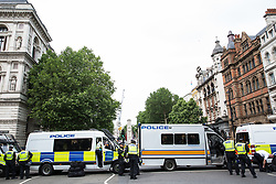 London, UK. 9th June, 2018. Metropolitan Police officers prepare a sterile area in Parliament Street between the far-right March for Tommy Robinson and anti-fascists holding a counter-protest.