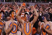 UVa fans cheer during an ACC football game against Duke Saturday in Charlottesville, VA. Duke won 28-17. Photo/Andrew Shurtleff'.
