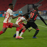 Nordi Mukiele (L) of RB Leipzig, Tyler Adams (C) of RB Leipzig and Sadio Mane (R) of Liverpool FC fight for the ball during the UEFA Champions League Round of 16 First Leg Football match between RB Leipzig and Liverpool FC in Budapest, Hungary on Feb. 16, 2021. ATTILA VOLGYI