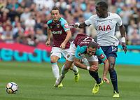 Football - 2017 / 2018 Premier League - West Ham United vs Tottenham Hotspur<br /> <br /> Moussa Sissoko (Tottenham FC)  fouls Javier (Chicharito) Hernandez (West Ham United) in trying to reachthe ball at the London Stadium<br /> <br /> COLORSPORT/DANIEL BEARHAM