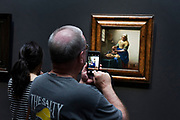 photographing the famous painting The Milkmaid by Vermeer in the Rijksmuseum Amsterdam