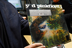 © Licensed to London News Pictures. 13/04/2019. LONDON, UK. A customer shows off a newly purchased album by Pink Floyd. Analogue music fans visit independent record shops in Soho to celebrate vinyl music on the 12th Record Store Day.  Over 200 independent record shops across the UK come together annually to celebrate the unique culture of analogue music with special vinyl releases made exclusively for the day.  In 2018, sales of vinyl rose for the 11th consecutive year to 4.2 million units according to the British Phonographic Industry (BPI).  Photo credit: Stephen Chung/LNP