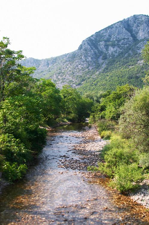 River near the winery. Durovic Jovo Winery, Dupilo village, wine region south of Podgorica. Vukovici Durovic Jovo Winery near Dupilo. Montenegro, Balkan, Europe.