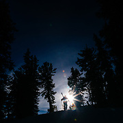 Andrew Whiteford and Kim Havell hike toward the sunlight in the Teton backcountry near Jackson Hole Mountain Resort in Teton Village, Wyoming.