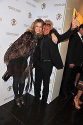 EVA HERZIGOVA and ROBERTO CAVALLI at a party hosted by Roberto Cavalli to celebrate his new Boutique's opening at 22 Sloane Street, London followed by a party at Battersea Power Station, London SW8 on 17th September 2011.