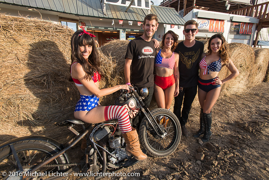 Buffalo Chip models with the Ives Brothers Wall of Death Flathead in front of the main stage at the Buffalo Chip during the annual Sturgis Black Hills Motorcycle Rally. SD, USA. August 10, 2016. Photography ©2016 Michael Lichter.