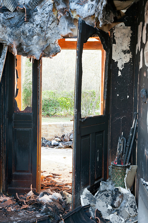 entrance in a totally burned out residential house