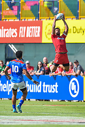 Rio Dyer of Wales claims the restart<br /> <br /> Photographer Craig Thomas/Replay Images<br /> <br /> World Rugby HSBC World Sevens Series - Day 2 - Friday 6rd December 2019 - Sevens Stadium - Dubai<br /> <br /> World Copyright © Replay Images . All rights reserved. info@replayimages.co.uk - http://replayimages.co.uk