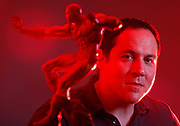 Director Jon Favreau is photographed behind an Iron Man figure at his office in Los Angeles.