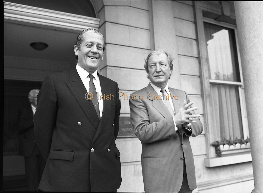 Tipp O'Neill At Iveagh House, Dublin.  (R61)..1987..10.07.1987..07.10.1987..10th July 1987..Mr Tipp 'Neill, Speaker of the House of Representatives in Washington DC paid a courtesy call at Iveagh House, Dublin today. Mr O'Neill was the guest of honour at a luncheon hosted by An Taoiseach, Charles Haughey and An Tanaiste, Brian Lenihan...Picture shows An Taoiseach, Mr Charles Haughey, and An Tanaiste Mr Brian Lenihan waiting on the steps of Iveagh House to meet Mr Tipp O'Neill.