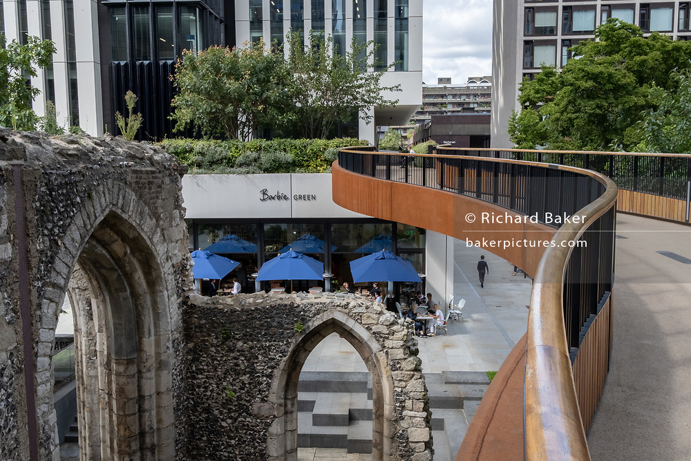 The ruined arches of St Alphage church and the modernist St. Alphage Highwalk on London Wall in the City of London, on 4th September 2020, in London, England. The earliest mention of St. Alphage goes back to the 1100s but was closed by act of Parliament in the late 1500s, one of the many victims of the dissolution of the monasteries - then damaged further in the Blitz.