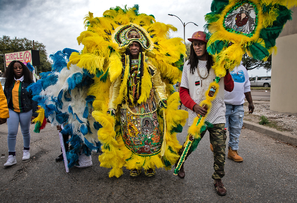 9th Ward Black Hatchet Mardi Gras Indians  headed to walkway under the Claiborne expressway overpass on Mardi Gras day in New Orleans.