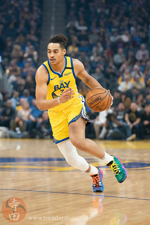 February 23, 2020; San Francisco, California, USA; Golden State Warriors guard Jordan Poole (3) dribbles the basketball during the first quarter against the New Orleans Pelicans at Chase Center.