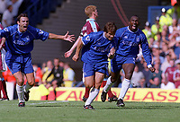Gianfranco Zola (Chelsea) celebrates his goal with Gustavo Poyet (left) and Jimmy Floyd Hasselbaink. Chelsea v West Ham United, 19/8/2000. Credit Colorsport / Nick Kidd