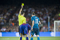 August 13, 2017 - Barcelona, Spain - The referee shows the yellow card to Gareth Bale during the match between FC Barcelona - Real Madrid, for the first leg of the Spanish Supercup, held at Camp Nou Stadium on 13th August 2017 in Barcelona, Spain. (Credit: Urbanandsport / NurPhoto) (Credit Image: © Urbanandsport/NurPhoto via ZUMA Press)