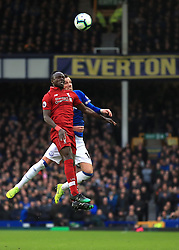 Liverpool's Sadio Mane (left) and Everton's Morgan Schneiderlin battle for the ball during the Premier League match at Goodison Park, Liverpool.