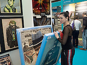 KARINA PINTEL ON AMY TRADING STAND, ARTWORK BY ROB BISHOP,The 2016 Ideal Home Exhibition. Kensington Olympia, 19March 2016