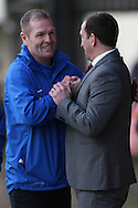 Scunthorpe manager Russ Wilcox (left) greets Newport County manager Justin Edinburgh.Skybet football league 2 match, Newport county v Scunthorpe Utd at Rodney Parade in Newport, South Wales on Saturday 1st March 2014.<br /> pic by Mark Hawkins, Andrew Orchard sports photography.