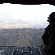 U.S. helicopter on the way to a remote village to deliver relief supplies and pick up injured earthquake victims to transport them to a medical facility.