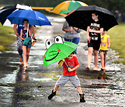 (Mara Lavitt — New Haven Register) <br /> July 4, 2014 Madison<br /> A wet Independence Day celebrated at Hammonasset Beach State Park. Three-year-old Aiden Dart of Chicopee, MA plays in the puddles as he and his family take a walk to the beach, despite the rain. The extended Dart family camps at Hammonasset several times a year.<br /> mlavitt@newhavenregister.com