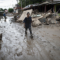 In the aftermath of hurricanes Eta and Iota, a man walks through the mud in La Planeta, San Pedro Sula, Honduras.<br /> <br /> Hurricanes Eta and Iota hit hard on the north coast of Honduras, leaving some areas flooded for three weeks, destroying people's furniture, belongings, vehicles and houses as well as standing crops.