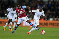 Modou Barrow of Swansea city is fouled by Aly Cissokho of Aston Villa (l) but having been booked earlier in the game the Villa player does not get a second yellow.  Barclays Premier league match, Swansea city v Aston Villa at the Liberty Stadium in Swansea, South Wales on Saturday 19th March 2016.<br /> pic by  Andrew Orchard, Andrew Orchard sports photography.