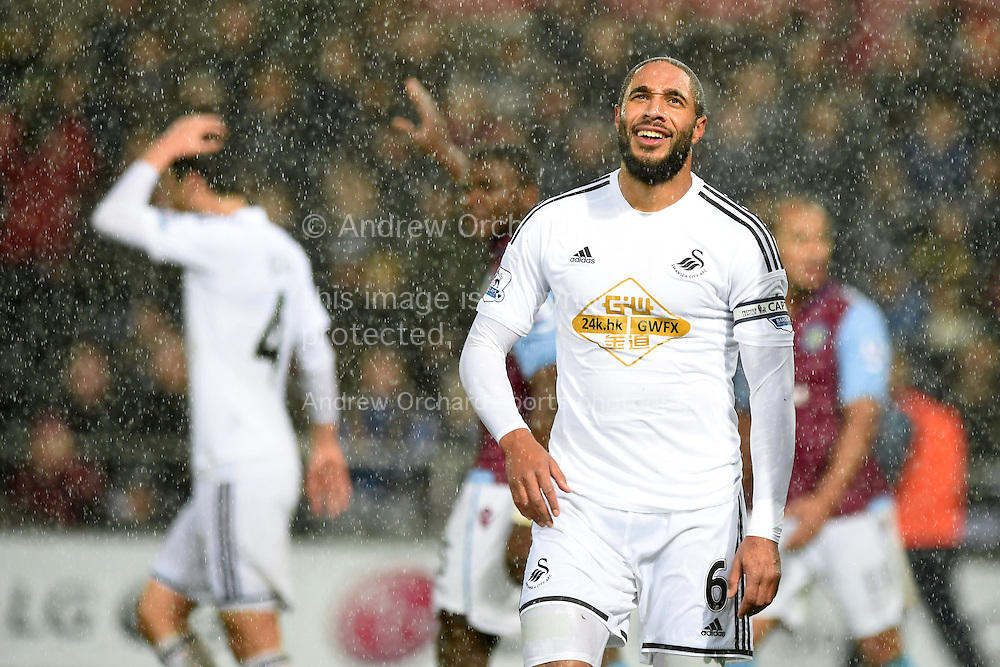 Ashley Williams, the Swansea city capt reacts after he just misses a goal chance.Barclays Premier league match, Swansea city v Aston Villa at the Liberty stadium in Swansea, South Wales on Boxing Day, Friday 26th December 2014<br /> pic by Andrew Orchard, Andrew Orchard sports photography.
