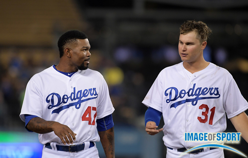 Sep 6, 2016; Los Angeles, CA, USA; Los Angeles Dodgers left fielder Howie Kendrick (47) and center fielder Joc Pederson (31) during a MLB game against the Arizona Diamondbacks at Dodger Stadium.