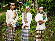 16 JUNE 2015 - CHANAE, NARATHIWAT, THAILAND:  Muslim men wait for a prayer service to start in Chanae. About 600 people from Muslim communities in Chanae district of Narathiwat province came to the district offices Tuesday morning to participate in a prayer for peace during Ramadan. About 6,000 people have been killed in sectarian violence in Thailand's three southern provinces of Narathiwat, Pattani and Yala since a Muslim insurgency started in 2004. Attacks usually spike during religious holidays. Insurgents are fighting for more autonomy from the central government in Bangkok.       PHOTO BY JACK KURTZ