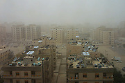 During a sandstorm in March 2003, and the USA invasion of Iraq, Kuwait City, Kuwait, gets blasted by high winds laden with desert sand from the north. (Supporting image from the project Hungry Planet: What the World Eats.)