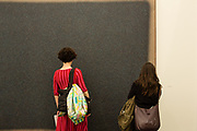 New York, NY - May 3, 2019. Spectators taking a close look at Paul Fägerskiöld's painting in the Peter Blum Gallery at the Frieze Art Fair on New York City's Randalls Island.