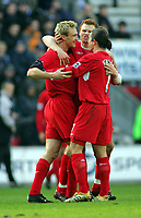 Sami Hyypia Celebrates Scoring goal with team mates<br />