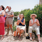 RAF fundraisers watch the Red Arrows, Britain's RAF aerobatic team during a private display high above RAF Akrotiri.