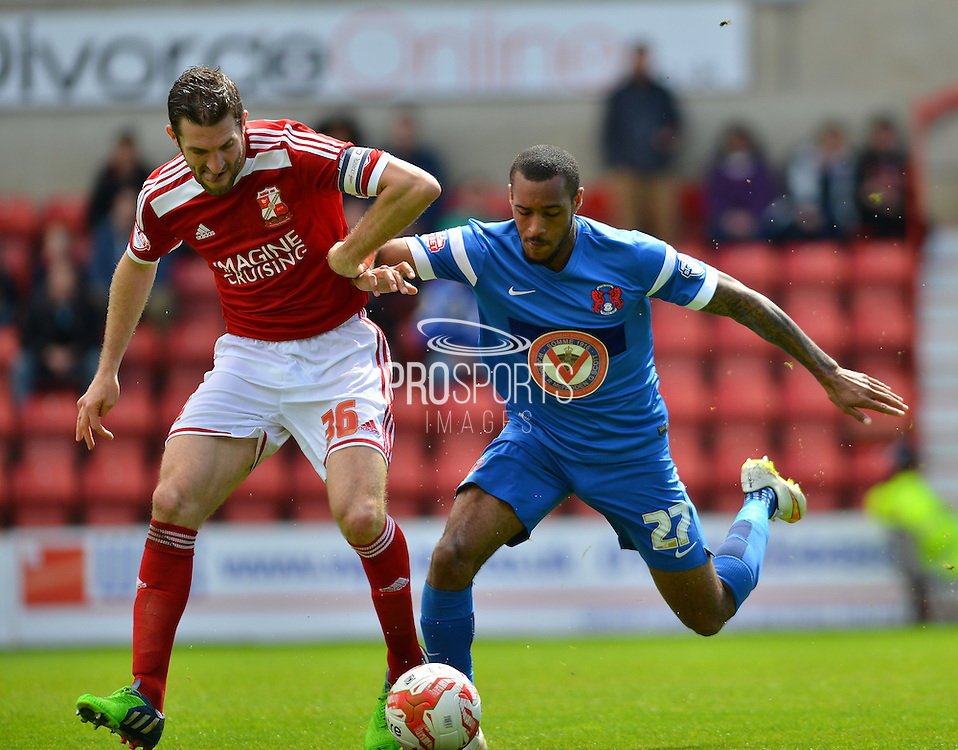 Leyton Orient's Jay Simpson and Swindon Towns Samuel Ricketts during the Sky Bet League 1 match between Swindon Town and Leyton Orient at the County Ground, Swindon, England on 3 May 2015. Photo by Mark Davies.