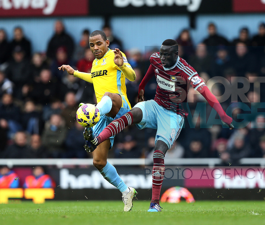 West Ham's Diafra Sakho tussles with Crystal Palace's Jason Puncheon<br /> <br /> Barclays Premier League - West Ham United  vs Crystal Palace  - Upton Park - England - 28th February 2015 - Picture David Klein/Sportimage