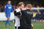 Gillingham defender Connor Ogilvie (34) down holding his nose during the EFL Sky Bet League 1 match between AFC Wimbledon and Gillingham at the Cherry Red Records Stadium, Kingston, England on 23 March 2019.