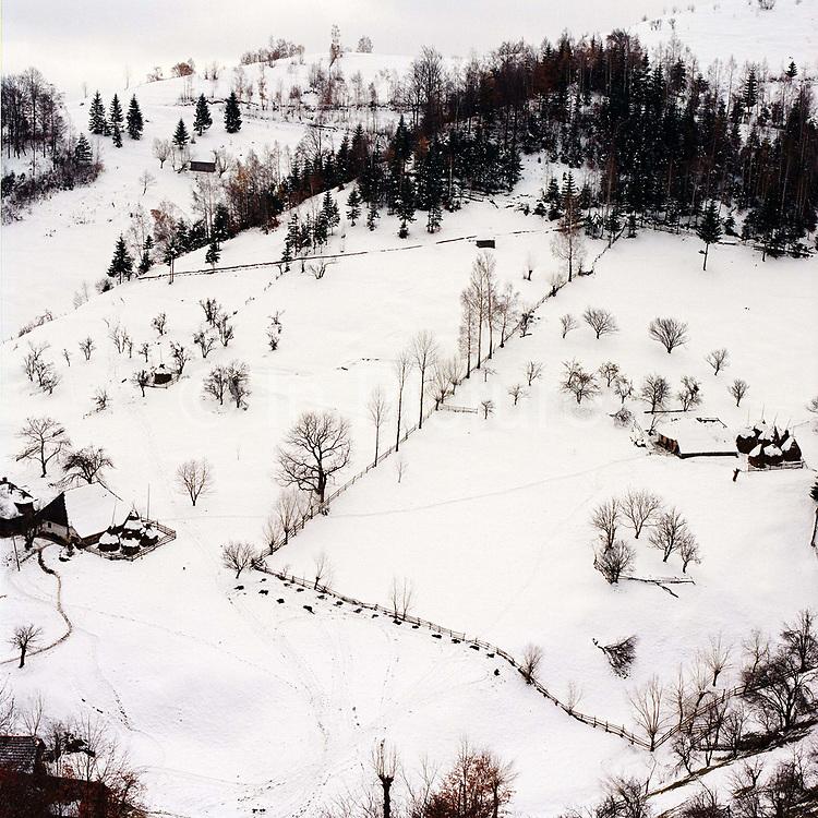 Snowy winter landscape view of Magura village in the remote Carpathian Mountains, Romania