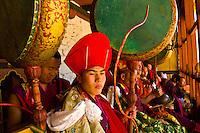 Monks drumming and watching at the Paro Tsechu (Festival), Paro, Bhutan