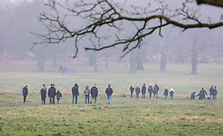 © Licensed to London News Pictures. 01/01/2021. London, UK. Members of the public enjoy a New Year's Day walk despite the cold, rain and snow flurries in Richmond Park, South West London today as temperatures dropped to -7c this morning in parts of the South East. On Wednesday the Oxford vaccine was approved for use, with the government securing over 100 million doses with an expected full rollout of vaccinations from Monday, January 4th 2021 as the coronavirus pandemic continues into the new year. UK. Photo credit: Alex Lentati/LNP