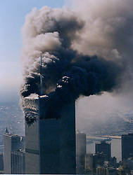 Aug. 24, 2011 - New York City, United States - World Trade Center on 9/11 shortly after the second tower had collapsed. On the morning of September 11, 2001, nineteen al-Qaeda terrorists hijacked four commercial passenger jet airliners. The hijackers intentionally crashed two of the airliners into the Twin Towers of the World Trade Center in New York City, the 1st at 8:46 a.m., American Airlines Flight 11 was crashed into the World Trade Center's North Tower, followed by United Airlines Flight 175, which hit the South Tower at 9:03 a.m, killing everyone on board and many others working in the buildings. Both towers collapsed within two hours, destroying nearby buildings and damaging others. Among the 2,752 victims who died in the attacks on the World Trade Center were 343 firefighters and 60 police officers from New York City and the Port Authority. (Credit Image: © Visual/ZUMAPRESS.com)