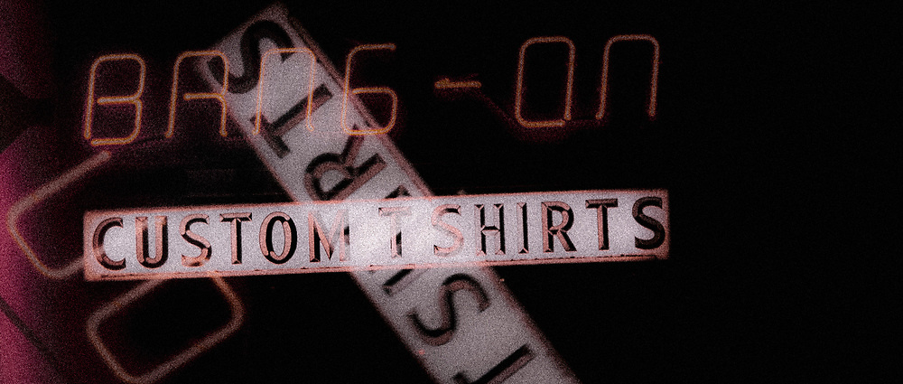 Bang-On Custom T Shirts neon sign as seen at night. Vancouver, British Columbia