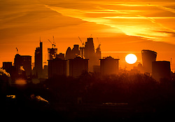 © Licensed to London News Pictures. 30/01/2018. London, UK. The view from Primrose Hill as the sun rises over The City of London. Photo credit: Peter Macdiarmid/LNP