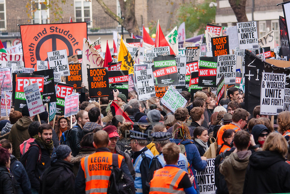 London, November 19th 2014. Thousands of students march through central London, demanding that education fees are scrapped by the government. PICTURED: Students gather on Malet Street outside University of London, prior to marching to Parliament.