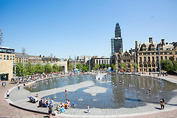 © Licensed to London News Pictures. 06/06/2016. Bradford UK. Families cool of in the water fountains at Bradford City park today in the soaring temperatures. Photo credit: Andrew McCaren/LNP