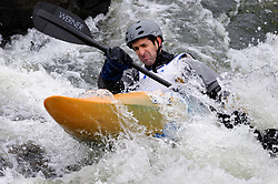 Joe Sartori of Chesterfield, Missouri races in the K1 men's master plastic class during the slalom course of the 42nd Annual Missouri Whitewater Championships. Sartori placed first place in the class. The Missouri Whitewater Championships, held on the St. Francis River at the Millstream Gardens Conservation Area, is the oldest regional slalom race in the United States.