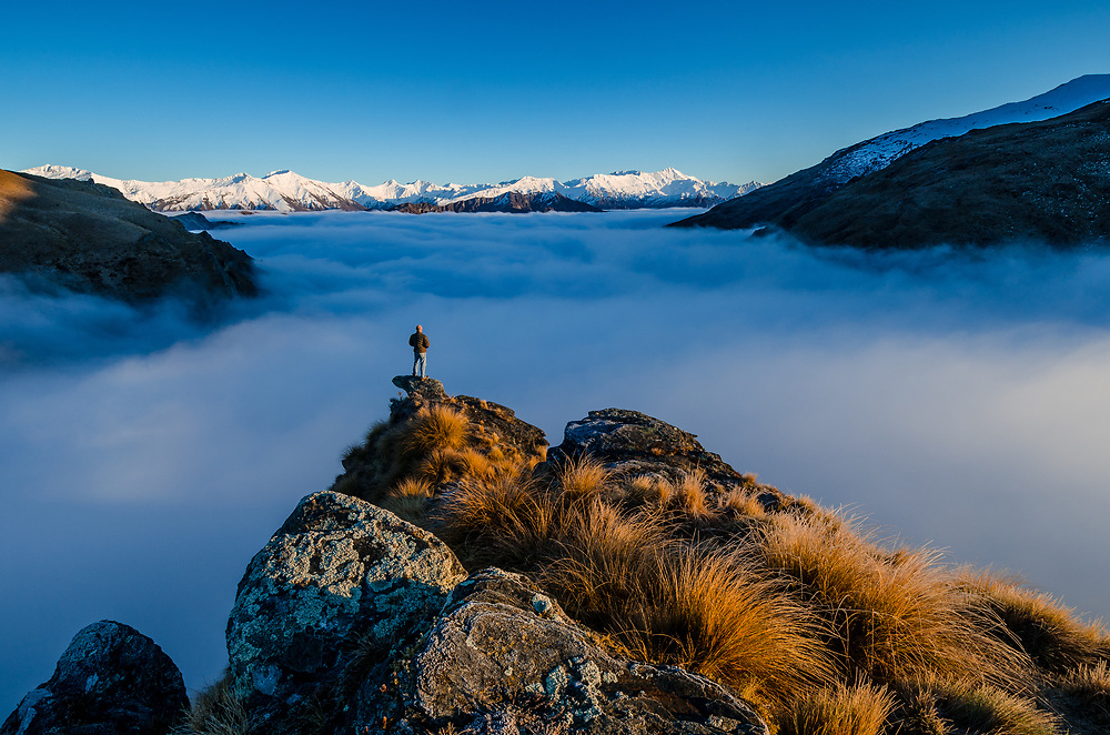 Man over looking the landscape of a inversion layer.