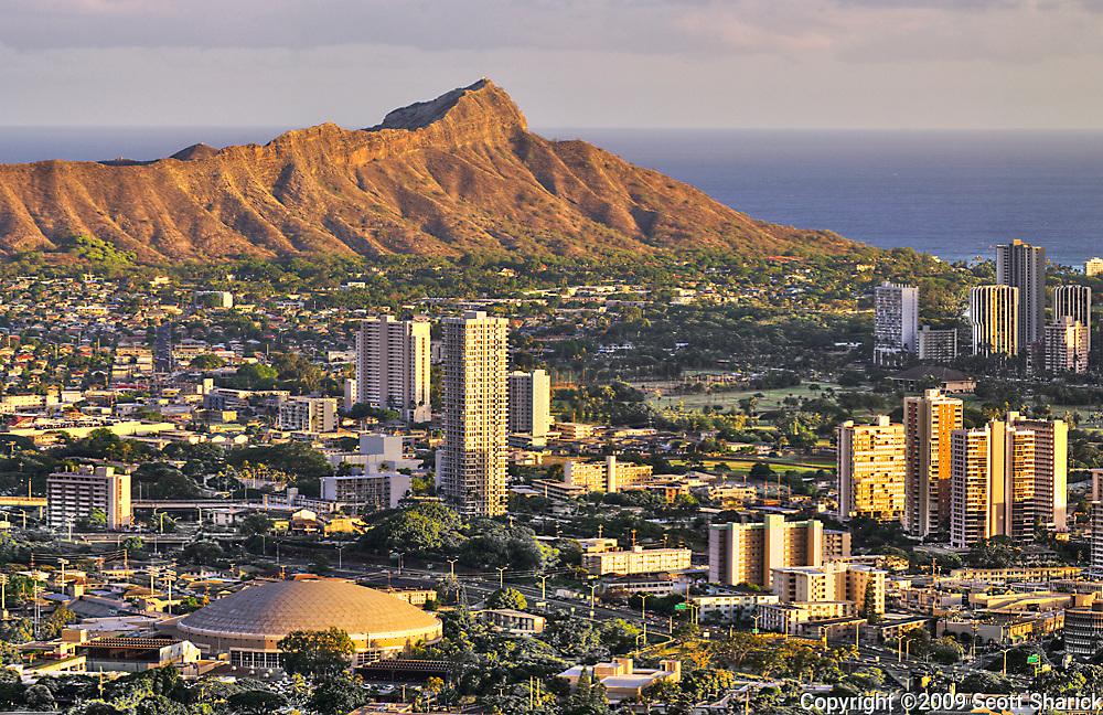The warm evening light hits Diamond Head crater on Oahu.