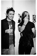David Sims and Iggy Pop. Kate Moss book party. James Danziger Gallery. New York. 11 September 1995. © Copyright Photograph by Dafydd Jones 66 Stockwell Park Rd. London SW9 0DA Tel 020 7733 0108 www.dafjones.com