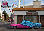 Pink Car being unveiled outside Las Vegas wedding chapel with Elvis sign,